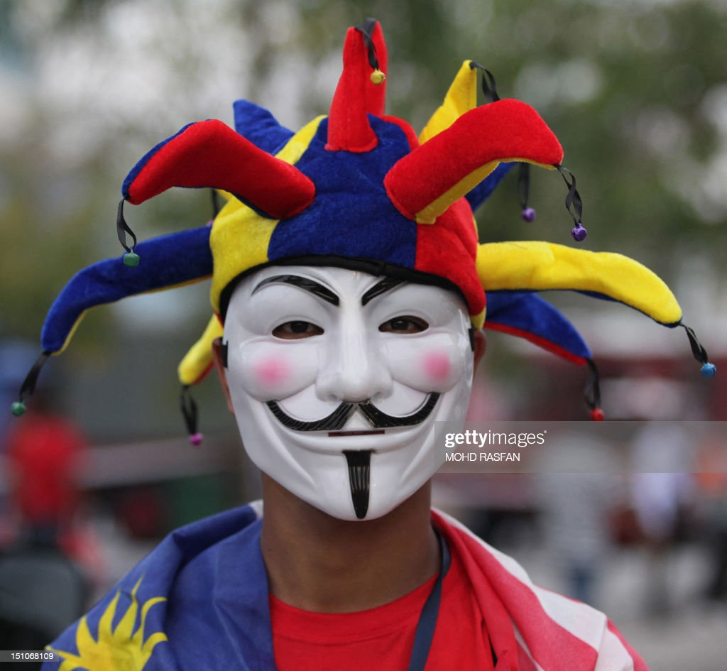 A Malaysian youth wearing a Guy Fawkes mask and a jester's hat poses during a rally to celebrate the country's 55th Independence Day in Bukit Jalil Stadium, some 20 kilometres south of Kuala Lumpur, on August 31, 2012. Malaysians gathered for the 'Perhimpunan Janji Ditepati' (Promises Fulfilled Gathering) in celebrating the country's 55th Independence Day.