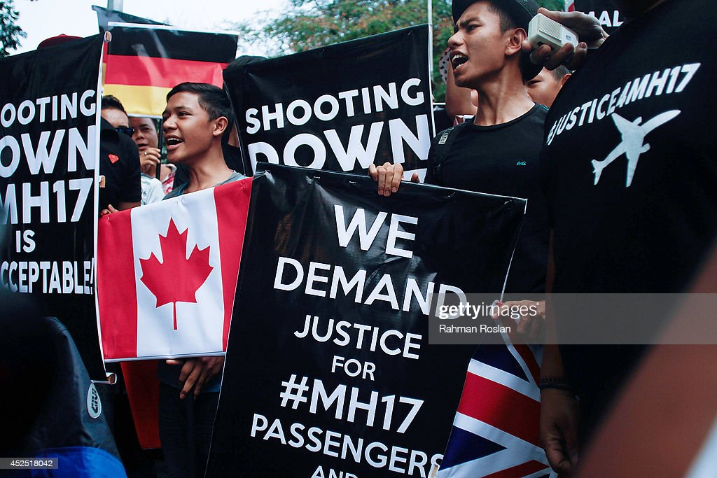 Malaysian youths protest against the downing of flight MH17 outside the Ukrainian embassy on July 22, 2014 in Kuala Lumpur, Malaysia. Malaysia Airlines flight MH17 was travelling from Amsterdam to Kuala Lumpur when it crashed killing all 298 on board including 80 children. The aircraft was allegedly shot down by a missile and investigations continue over the perpetrators of the attack.