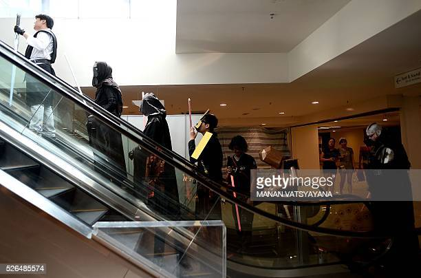 Malaysians dressed as popular 'Star Wars' characters take part in an event to mark the Star Wars Day celebration in Kuala Lumpur on April 30 2016 /...
