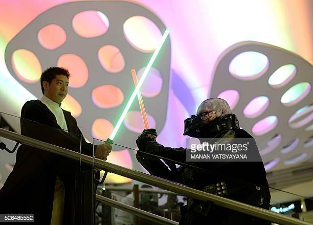 Malaysians William Wong dressed as popular 'Star Wars' character Obi Wan Kinobi and Khalil Ishak dressed as Darth Vader strike a pose during an event...