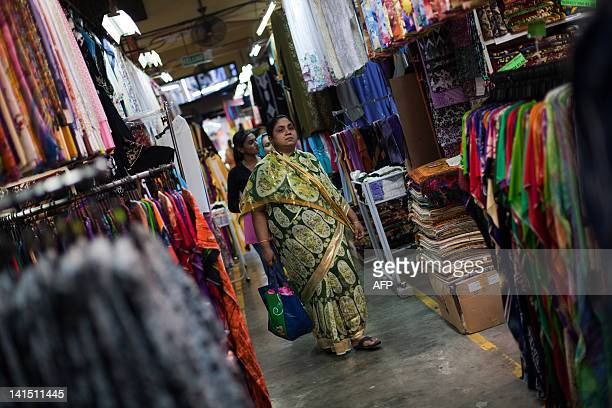 MalaysiapoliticsPenangheritageFEATURE by Dan Martin This picture taken on February 22 shows shoppers walking at the Penang bazaar in Georgetown some...