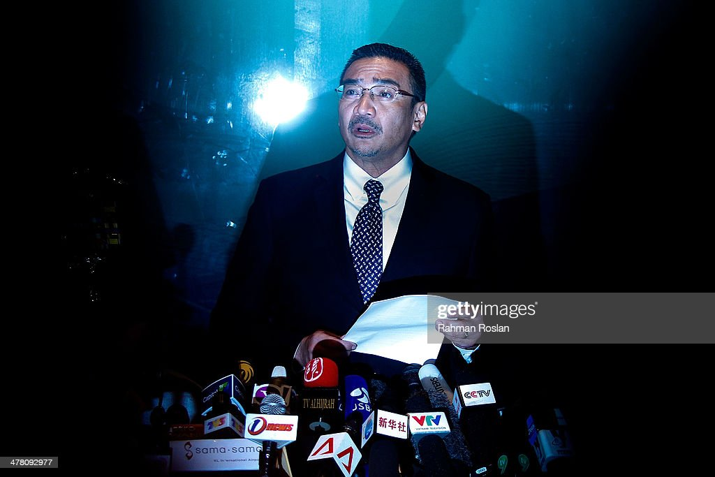 Malaysia's acting transport minister, <a gi-track='captionPersonalityLinkClicked' href=/galleries/search?phrase=Hishammuddin+Hussein&family=editorial&specificpeople=774002 ng-click='$event.stopPropagation()'>Hishammuddin Hussein</a> speaks to the media at the Kuala Lumpur International Airport on March 12, 2014 in Kuala Lumpur, Malaysia. Officials have expanded the search area for missing Malaysia Airlines flight MH370 beyond the intended flight path to include the west of Malaysia at the Straits of Malacca as new information surfaces about the time Subang air traffic control lost contact with the aircraft. The flight carrying 239 passengers from Kuala Lumpur to Thailand was reported missing on the morning of March 8 after the crew failed to check in as scheduled.
