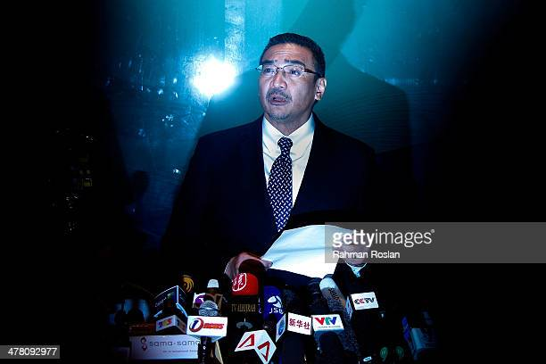 Malaysia's acting transport minister Hishammuddin Hussein speaks to the media at the Kuala Lumpur International Airport on March 12 2014 in Kuala...