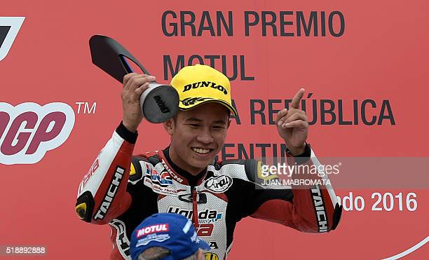 Malaysia's biker Khairul Idham Pawi celebrates on the podium after winning the Moto3 race of the Argentina Grand Prix at Termas de Rio Hondo circuit...