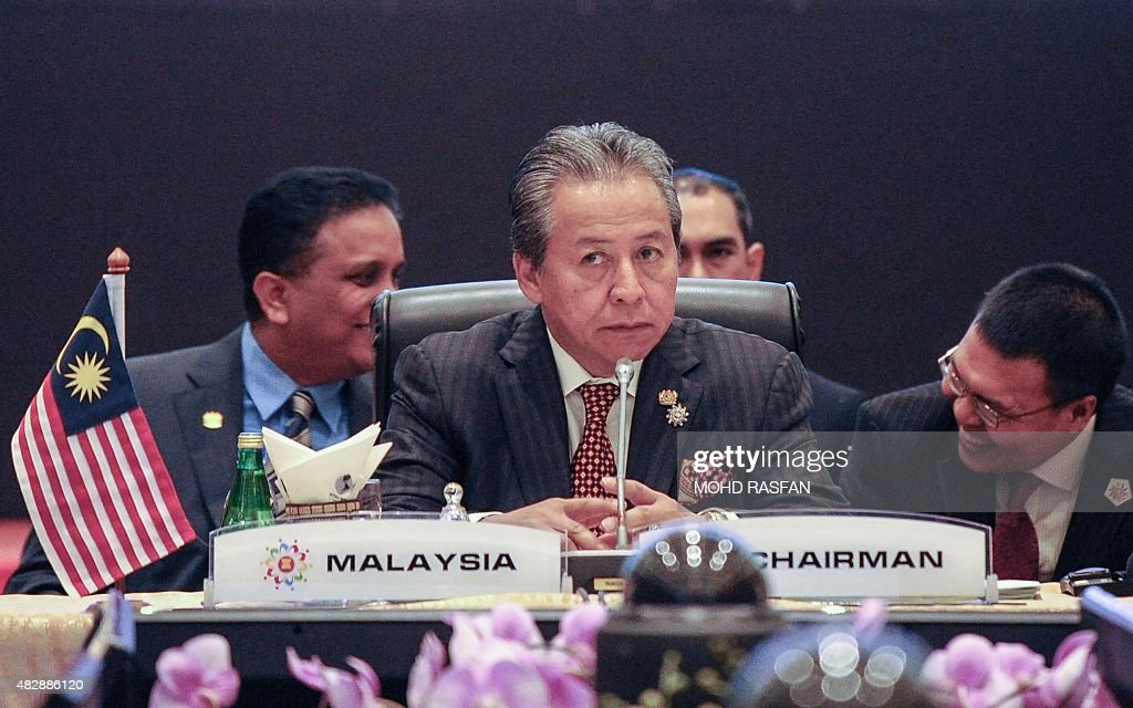Malaysia's Foreign Minister <a gi-track='captionPersonalityLinkClicked' href=/galleries/search?phrase=Anifah+Aman&family=editorial&specificpeople=5958202 ng-click='$event.stopPropagation()'>Anifah Aman</a> (C) takes his seat before the start of the 48th Association of Southeast Asian Nations (ASEAN) Foreign Ministers Meeting (AMM) at the Putra World Trade Centre in Kuala Lumpur on August 4, 2015. AFP PHOTO / MOHD RASFAN