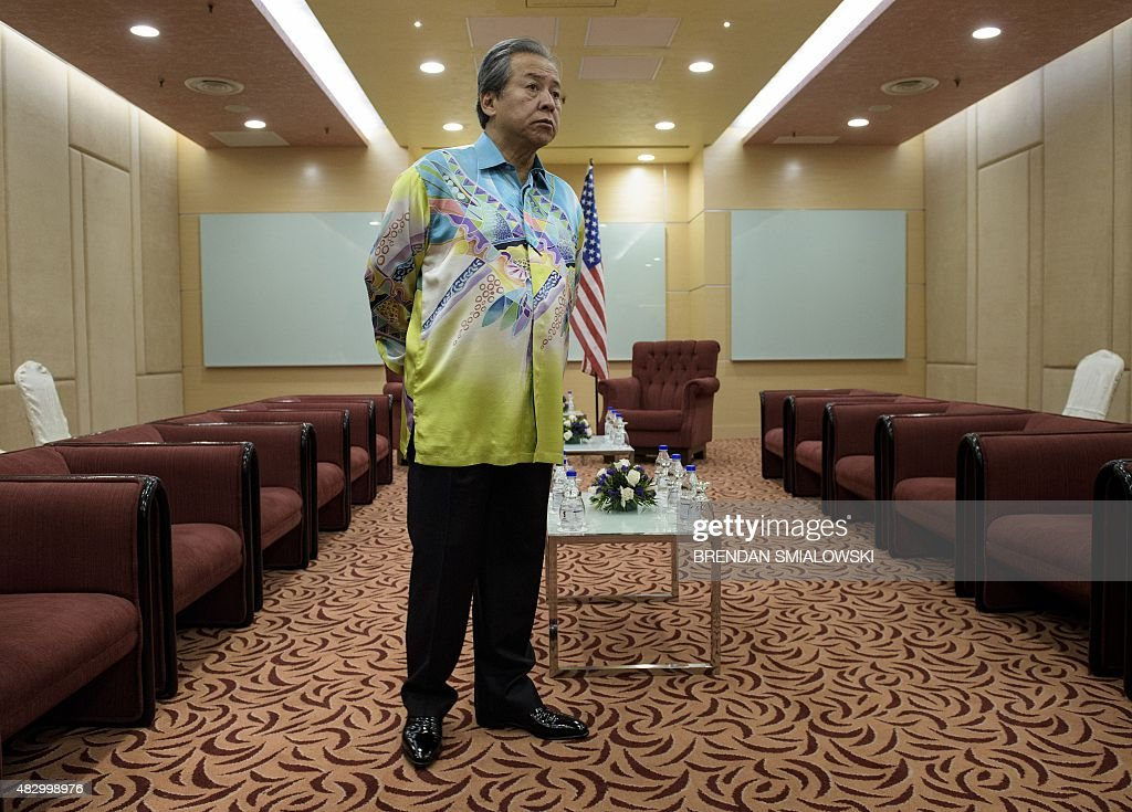 Malaysia's Foreign Minister <a gi-track='captionPersonalityLinkClicked' href=/galleries/search?phrase=Anifah+Aman&family=editorial&specificpeople=5958202 ng-click='$event.stopPropagation()'>Anifah Aman</a> waits for US Secretary of State John Kerry before a bilateral meeting in Kuala Lumpur on August 5, 2015 .