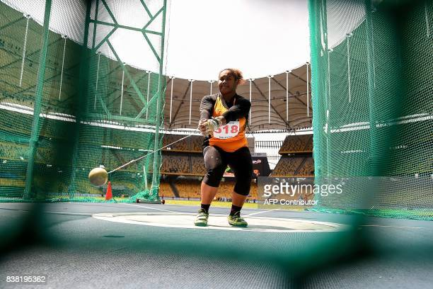 Malaysia's Grace Wong Xiu Mei competes in the women's hammerthrow athletics final of the 29th Southeast Asian Games at the Bukit Jalil national...