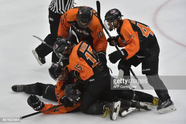 Malaysia's ice hockey team players celebrate a goal during their round robin ice hockey game against the Philippines during the 29th Southeast Asian...