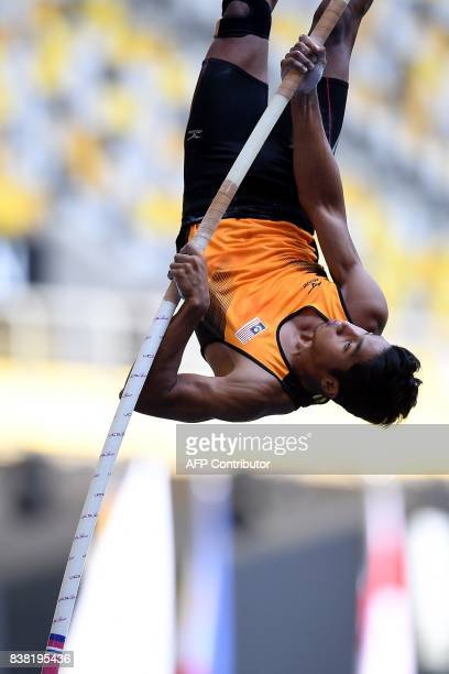 Malaysia's Iskandar Bin Alwi competes in the men's polevault athletics final of the 29th Southeast Asian Games at the Bukit Jalil national stadium in...