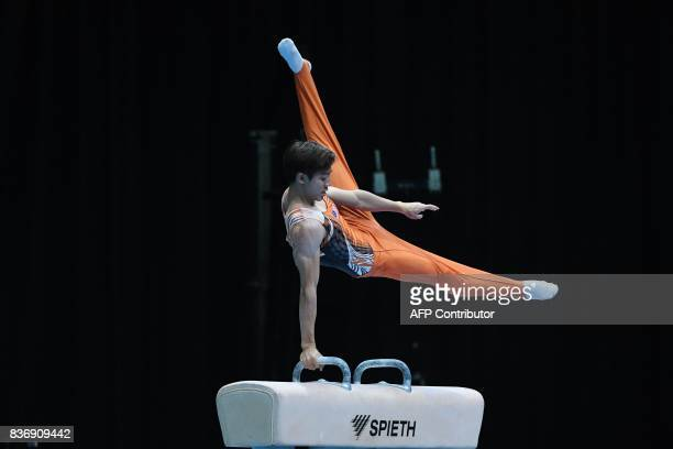 Malaysia's Jeremiah Loo Phay Xing competes in the men's pommel horse gymnastics event at the 29th Southeast Asian Games in Kuala Lumpur on August 22...