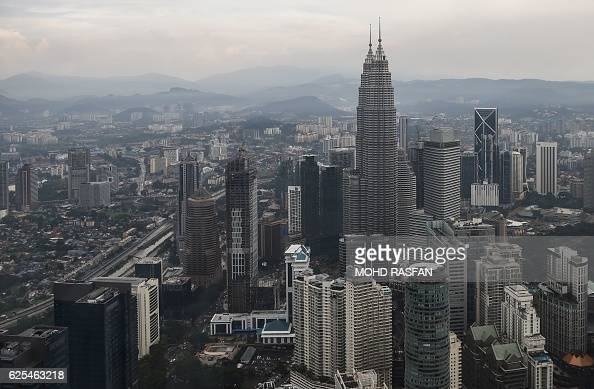 Malaysia's landmark Petronas Twin Towers and other commercial buildings are seen after a heavy downpour from the KL Tower observation deck in Kuala...