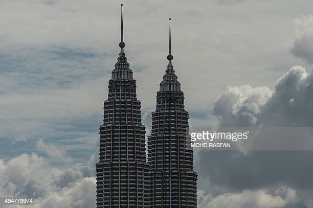 Malaysia's landmark Petronas Twin Towers in Kuala Lumpur are seen clear from the haze that has shrouded Malaysia in recent weeks on October 29 2015...