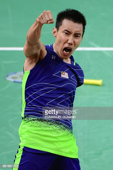 TOPSHOT Malaysia's Lee Chong Wei celebrates after winning against China's Lin Dan during their men's singles semifinal badminton match at the...