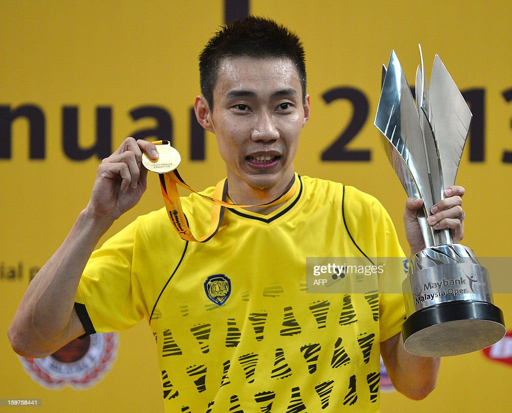 Malaysia's Lee Chong Wei celebrates with his trophy and his gold medal during the awards ceremony after defeating Indonesia's Sony Dwi Kuncoro in the men's single final at the Malaysia Open Badminton Superseries in Kuala Lumpur on January 20, 2013.