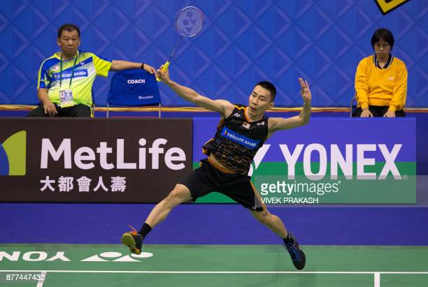 Malaysia's Lee Chong Wei hits a shot against China's Tian Houwei during their first round men's singles match at the Hong Kong Open badminton...