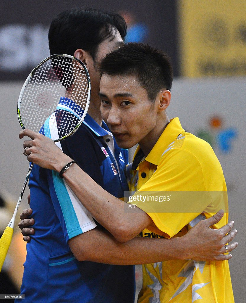 Malaysia's Lee Chong Wei (R) hugs his coach after his victory over Indonesia's Sony Dwi Kuncoro in their men's singles final at the Malaysia Open Badminton Superseries in Kuala Lumpur on January 20, 2013.