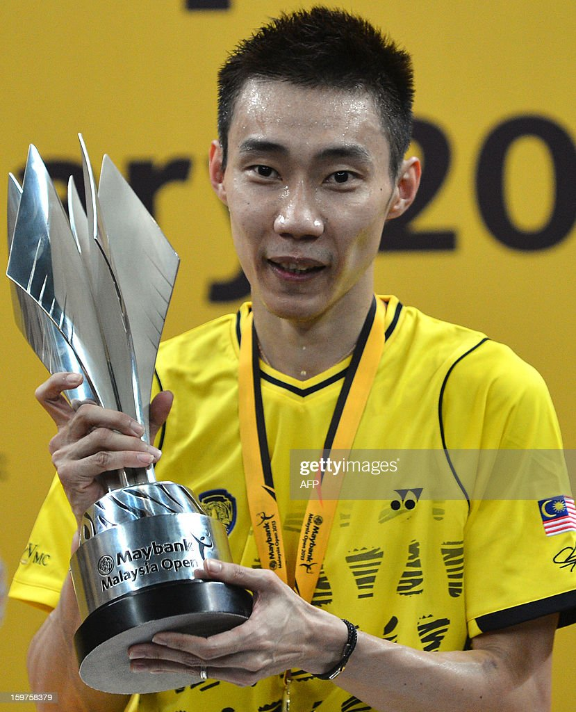 Malaysia's Lee Chong Wei poses with the trophy during the awards ceremony after defeating Indonesia's Sony Dwi Kuncoro in the men's single final at the Malaysia Open Badminton Superseries in Kuala Lumpur on January 20, 2013.