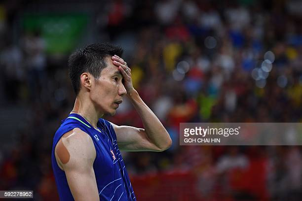 TOPSHOT Malaysia's Lee Chong Wei reacts against China's Chen Long during their men's singles Gold Medal badminton match at the Riocentro stadium in...