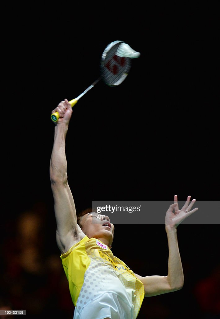 Malaysia's Lee Chong Wei returns to China's Chen Long during their All England Open Badminton Championships men's singles final match in Birmingham, central England, on March 10, 2013. AFP PHOTO/BEN STANSALL