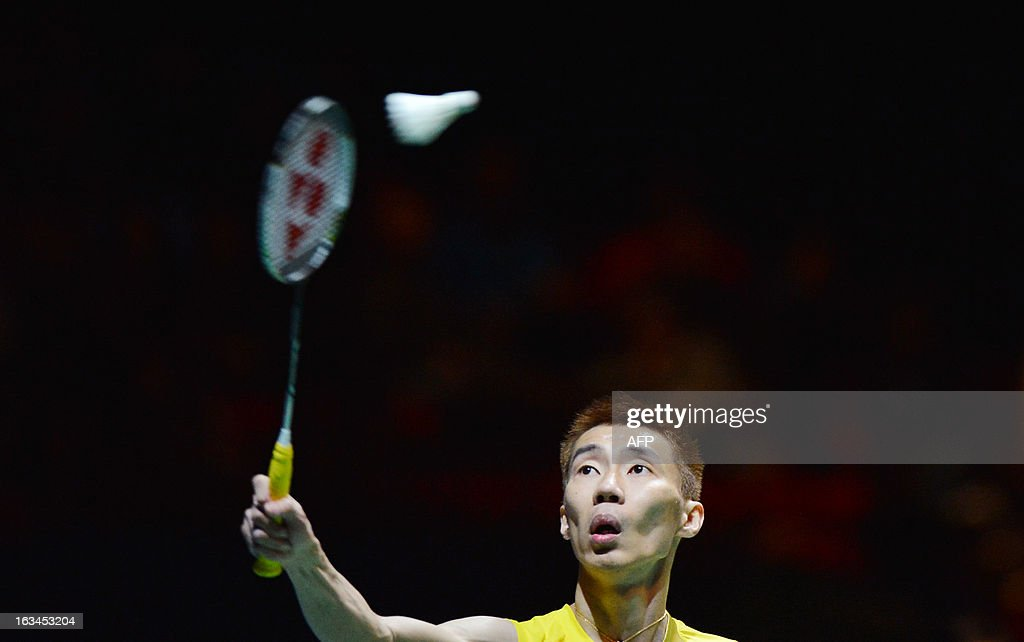 Malaysia's Lee Chong Wei returns to China's Chen Long during their All England Open Badminton Championships men's singles final match in Birmingham, central England, on March 10, 2013.