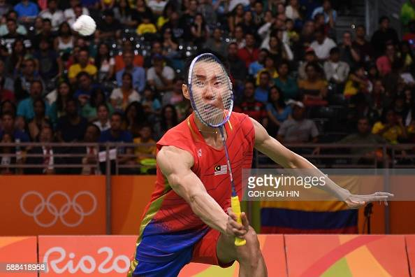 TOPSHOT Malaysia's Lee Chong Wei returns to Surinam's Soren Opti during their men's singles qualifying badminton match at the Riocentro stadium in...