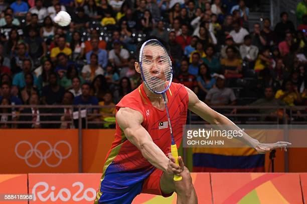 TOPSHOT Malaysia's Lee Chong Wei returns to Surinam's Soren Opti during their men's singles qualifying badminton match at the Riocentro stadium in...