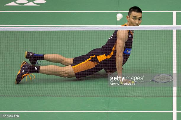 Malaysia's Lee Chong Wei watches his shot against China's Tian Houwei after he slipped during their first round men's singles match at the Hong Kong...