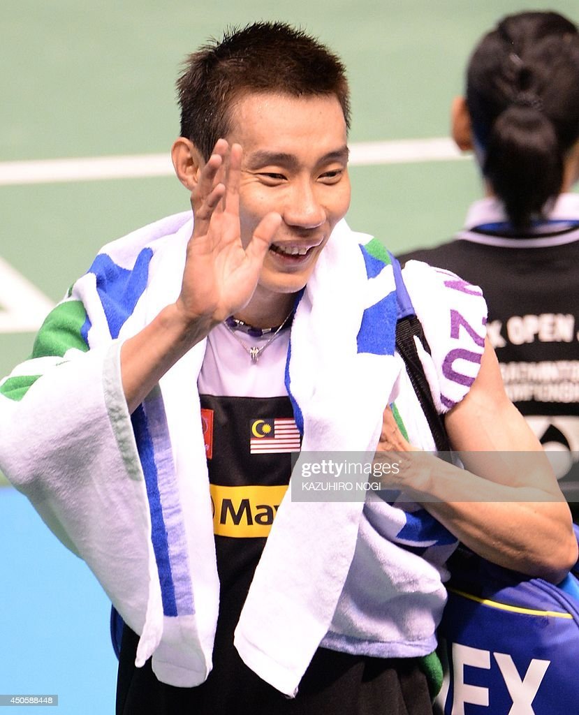Malaysia's Lee Chong Wei waves to fans as he leaves the court after beating Japan's Kenichi Tago during their men's singles semi-final match at the Japan Open badminton tournament in Tokyo on June 14, 2014.