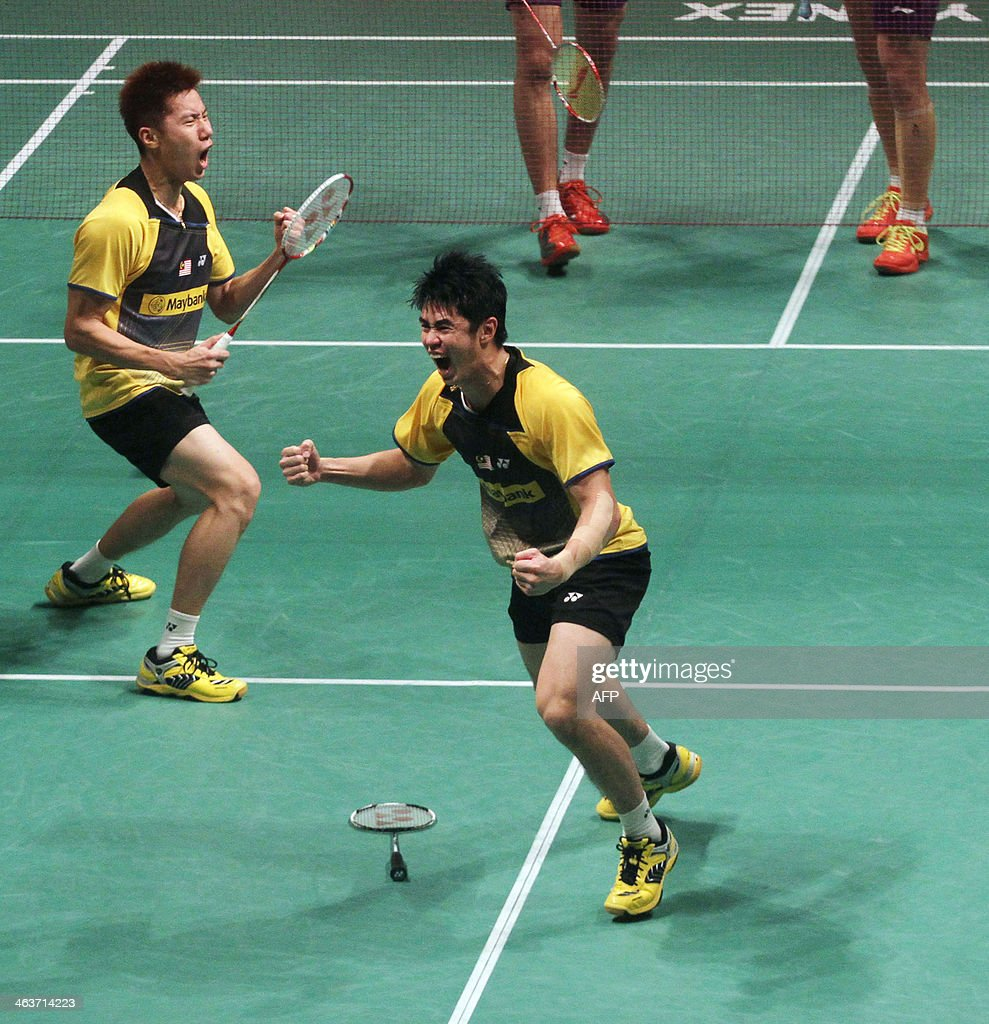 Malaysia s Lim Khim Wah R and Goh V Shem celebrate after winning