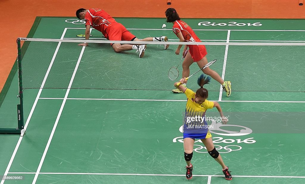 Malaysia's Liu Ying Goh and Malaysia's Peng Soon Chan react after winning against China's Xu Chen and China's Ma Jin during their mixed doubles...