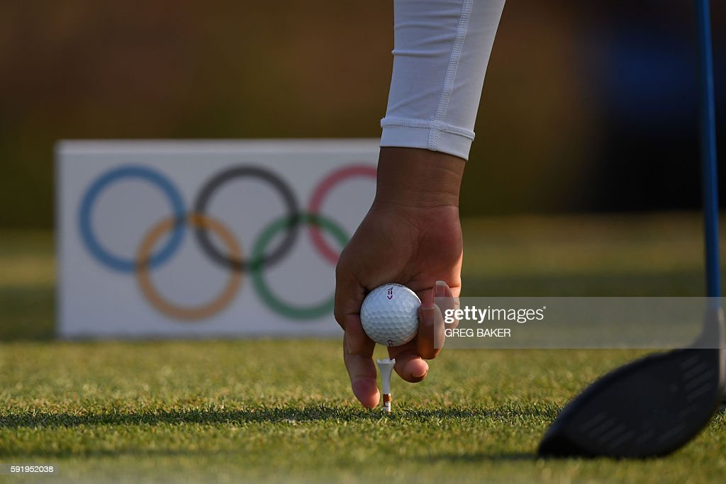 Malaysia's Michelle Koh puts her ball on the tee during the Women's individual stroke play at the Olympic Golf course during the Rio 2016 Olympic...