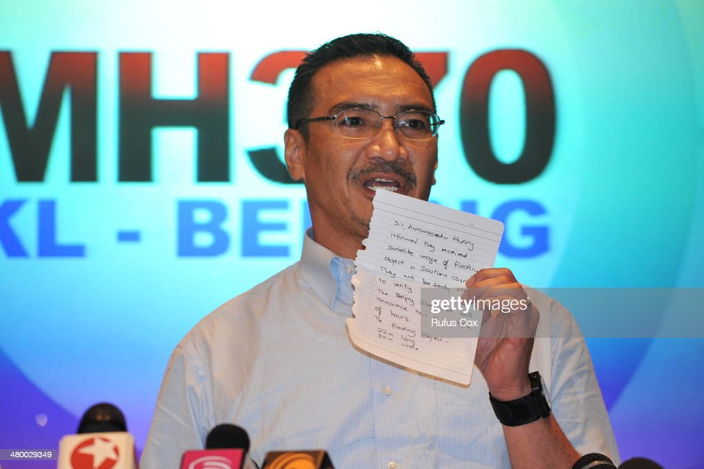 Malaysia's Minister of Defence and acting Minister of Transport <a gi-track='captionPersonalityLinkClicked' href=/galleries/search?phrase=Hishammuddin+Hussein&family=editorial&specificpeople=774002 ng-click='$event.stopPropagation()'>Hishammuddin Hussein</a> shows a note of latest information from Chinese officials during a press conference on March 22, 2014 in Kuala Lumpur, Malaysia. The press conference was interrupted with breaking news that Chinese satellites had captured large floating debris, potentially from Malaysia Airlines flight MH370, in the southern Indian Ocean. The search for missing flight MH370 has now entered its third week.