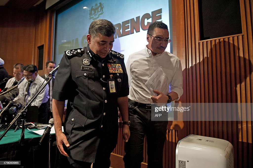 Malaysia's Minister of Defence and Acting Transport Minister Hishammuddin Hussein (R) and Malaysia's police chief Khalid Abu Bakar (L) leave after conducting a press conference at a hotel near Kuala Lumpur International Airport in Sepang on March 16, 2014. Malaysia said on March 16 that police had searched the homes of the pilots of the missing jet and examined a home flight simulator after revelations that the flight was deliberately diverted triggered a full-scale criminal probe.