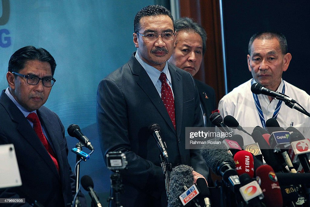 Malaysia's Minister of Defence and Acting Transport Minister Hishammuddin Hussein (2R) listens to questions from the floor during a press conference on March 20, 2014 in Kuala Lumpur, Malaysia. Australian authorities today received satellite imagery that shows two large objects in the Indian Ocean that may be debris from missing Malaysia Airlines flight MH370. The airliner went missing nearly two weeks ago carrying 239 passengers and crew on route from Kuala Lumpur to Beijing.