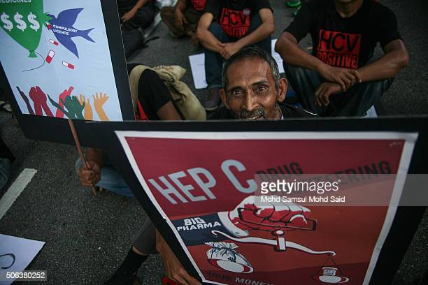 Malaysia's nongovernmental organization hold a placard in protest against the controversial TransPacific Partnership Agreement near the Merdeka...