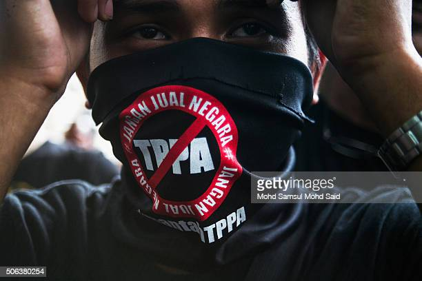 Malaysia's nongovernmental organization wearing a TPPA mask in protest against the controversial TransPacific Partnership Agreement near the Merdeka...
