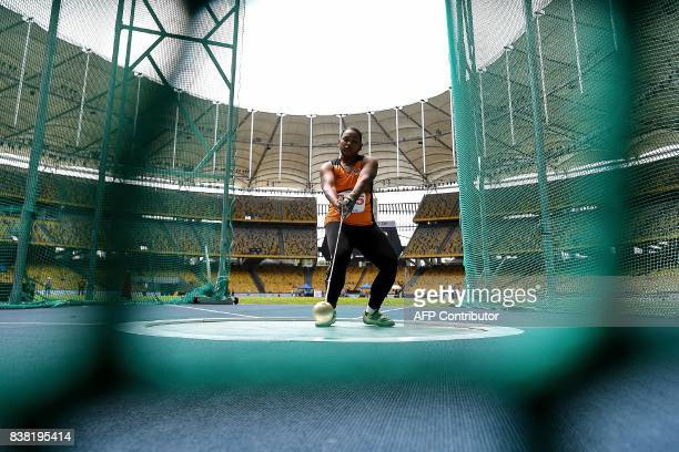 Malaysia's Nurfazira Jalaludin competes in the women's hammerthrow athletics final of the 29th Southeast Asian Games at the Bukit Jalil national...