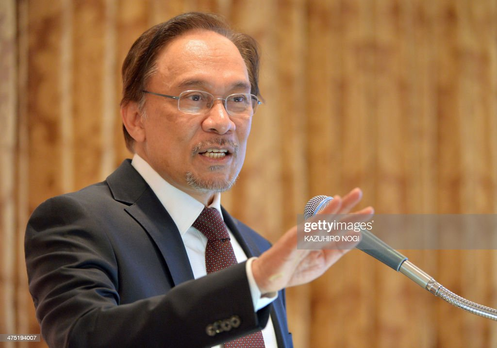 Malaysia's opposition leader <a gi-track='captionPersonalityLinkClicked' href=/galleries/search?phrase=Anwar+Ibrahim&family=editorial&specificpeople=600601 ng-click='$event.stopPropagation()'>Anwar Ibrahim</a> delivers a speech during a lecture hosted by Japan's Sasakawa Peace Foundation in Tokyo on February 27, 2014. Anwar arrived in Tokyo around a month after being barred entry to Japan because of his conviction for sodomy. AFP PHOTO / KAZUHIRO NOGI