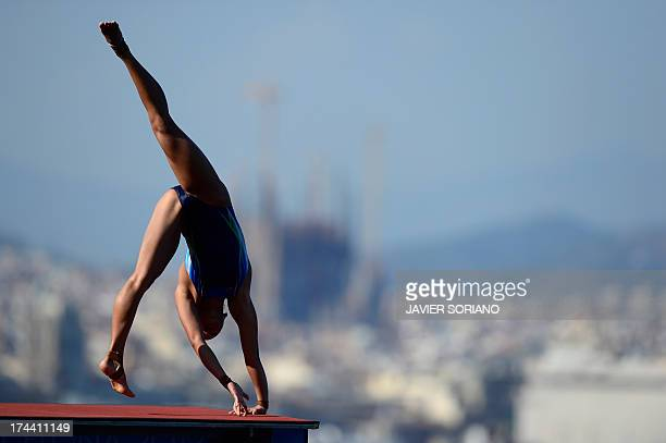 Malaysia's Pandelela Rinong Pamg loses her balance in a handstand incurring a points penalty as she competes in the women's 10metre platform final...