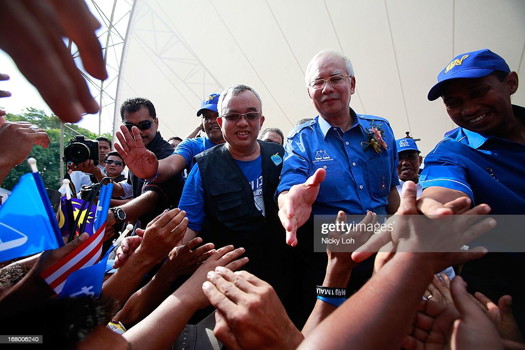 Malaysia's Prime Minister and Barisan Nasional (BN) chairman Najib Razak greets supporters during an election rally to address young parliamentary constituency voters at his hometown on May 4, 2013 in Pekan, Malaysia. The election, set for May 5, will see incumbent PM Najib Razak face Anwar Ibrahim, whose opposition coalition includes moderates, Islamists and Malaysians of Chinese descent