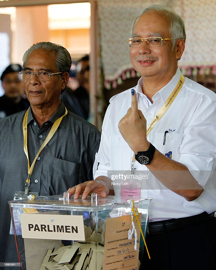 Malaysia's Prime Minister and Barisan Nasional (BN) chairman Najib Razak casts his vote at a polling station during election day on May 5, 2013 in Pekan, Malaysia. Millions of Malaysians casted their vote on Sunday in one of the most tightly contested Malaysian election since independence in 1957. The opposition coalition, Pakatan Rakyat (PeopleÕs Alliance), led by former deputy prime minister Anwar Ibrahim is seeking to gain power on a national level against the ruling party Barisan Nasional.