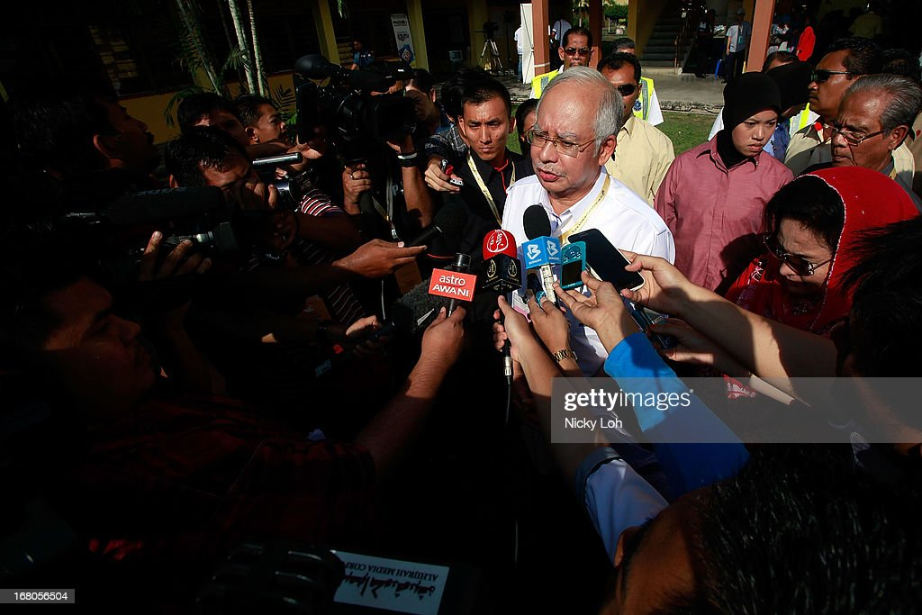 Malaysia's Prime Minister and Barisan Nasional (BN) chairman Najib Razak talks to the media during election day on May 5, 2013 in Pekan, Malaysia. Millions of Malaysians casted their vote on Sunday in one of the most tightly contested Malaysian election since independence in 1957. The opposition coalition, Pakatan Rakyat (PeopleÕs Alliance), led by former deputy prime minister Anwar Ibrahim is seeking to gain power on a national level against the ruling party Barisan Nasional.
