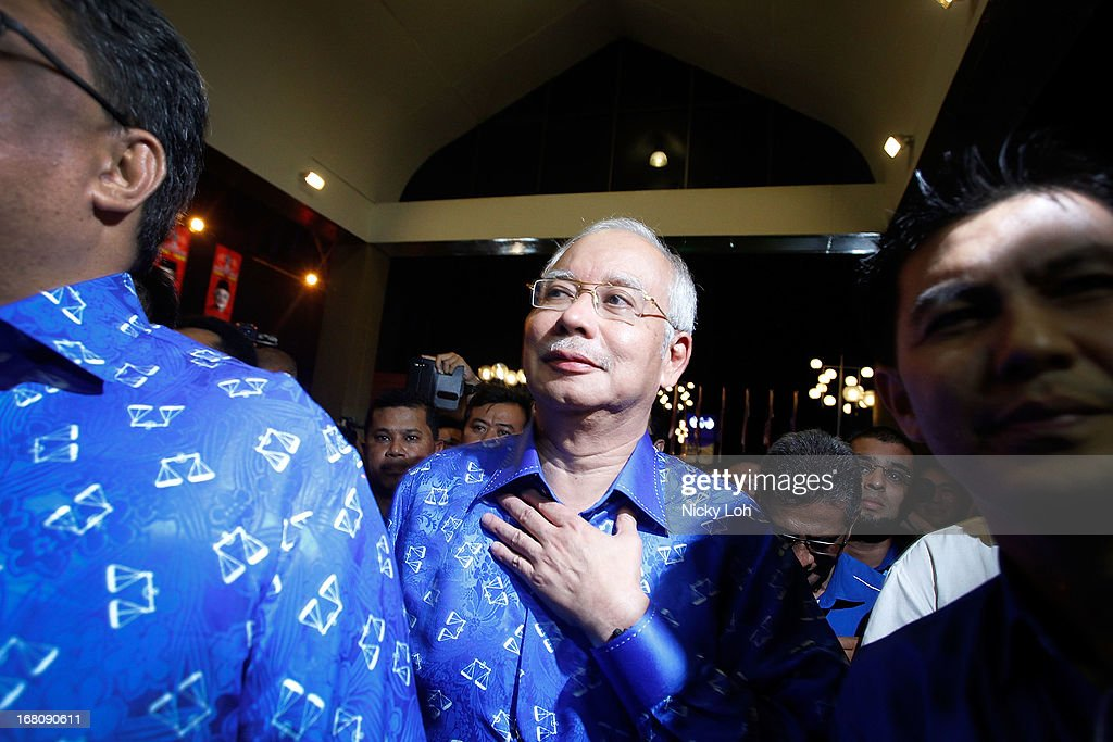 Malaysia's Prime Minister and Barisan Nasional (BN) chairman Najib Razak (C) arrives at UMNO headquarters during election day on May 5, 2013 in Kuala Lumpur, Malaysia. Millions of Malaysians casted their vote on Sunday in one of the most tightly contested Malaysian elections since independence in 1957. The opposition coalition, Pakatan Rakyat (People's Alliance), led by former deputy prime minister Anwar Ibrahim is seeking to gain power on a national level against the ruling party Barisan Nasional.