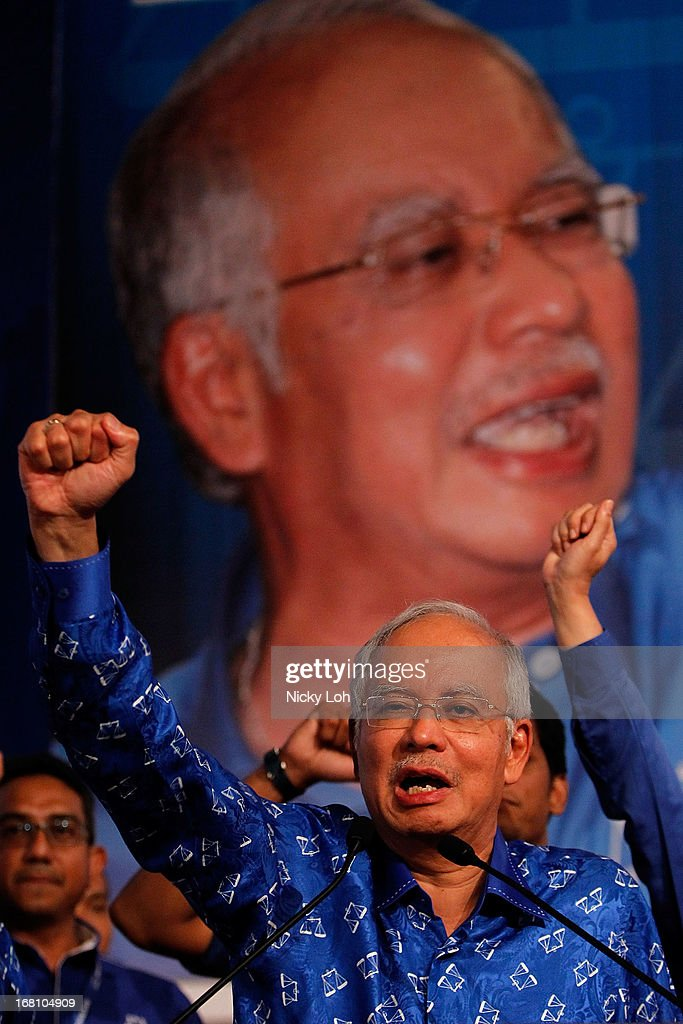 Malaysia's Prime Minister and Barisan Nasional (BN) chairman Najib Razak celebrates his victory on election day at the PWTC on May 6, 2013 in Kuala Lumpur, Malaysia. Malaysia Prime Minister Najib Razak's coalition won a simple majority in the country's election, defeating Anwar Ibrahim's opposition alliance and extending its 56-year hold on power.