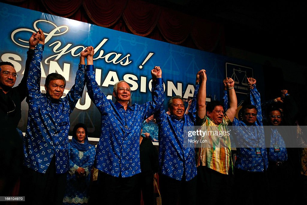 Malaysia's Prime Minister and Barisan Nasional (BN) chairman Najib Razak (3L) celebrates his victory on election day at the PWTC on May 6, 2013 in Kuala Lumpur, Malaysia. Malaysia Prime Minister Najib Razak's coalition won a simple majority in the country's election, defeating Anwar Ibrahim's opposition alliance and extending its 56-year hold on power.