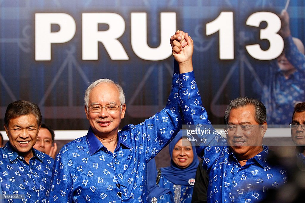 Malaysia's Prime Minister and Barisan Nasional (BN) chairman Najib Razak (2nd L) celebrates his victory with Deputy Prime Minister Muhyiddin Yassin on election day at the PWTC on May 5, 2013 in Kuala Lumpur, Malaysia. Malaysia Prime Minister Najib Razak's coalition won a simple majority in the country's election, defeating Anwar Ibrahim's opposition alliance and extending its 55-year hold on power.