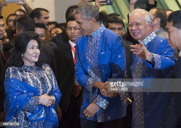 Malaysia's Prime Minister Najib Razak and his wife Rosmah Mansor greet US President Barack Obama prior to the ASEAN and East Asia Summit Leaders...