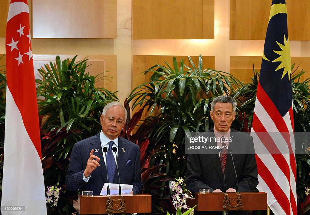 Malaysia's Prime Minister Najib Razak (L) and Singapore's Prime Minister Lee Hsien Loong (R) take part in a joint press conference after their leaders retreat meeting in Singapore on February 19, 2013. Singapore and Malaysia announced plans on February 19 to build a high-speed rail link, fuelling hopes that Southeast Asia could one day enjoy a rapid European-style train system connected to China.