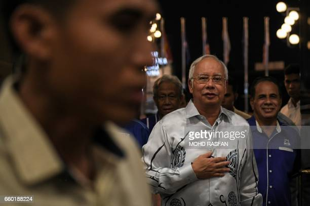 Malaysia's Prime Minister Najib Razak arrives for the United Malays National Organisation supreme council meeting in Kuala Lumpur on March 29 2017...