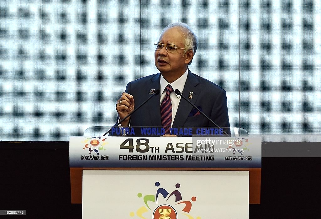Malaysia's Prime Minister Najib Razak gestures as he addresses the opening ceremony for the 48th ASEAN Foreign Ministers Meeting at the Putra World...